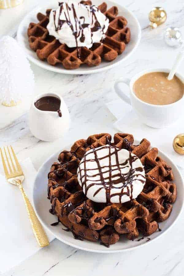 Chocolate Eggnog Waffles are a warm and cozy way to welcome the holiday season. Don't forget the whipped cream and chocolate drizzle!
